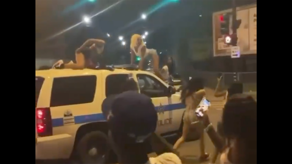 Disgusting Video Shows Women Twerking on Moving Cop Car, Because ... Justice?